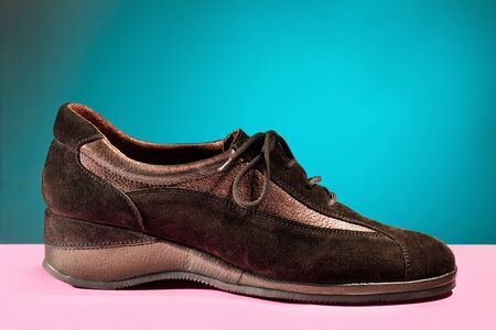 A pair of brown womens shoes autumn fashion on colorful background. Stock Photo