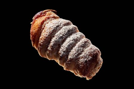 Shot of fresh pastries isolated on black background.