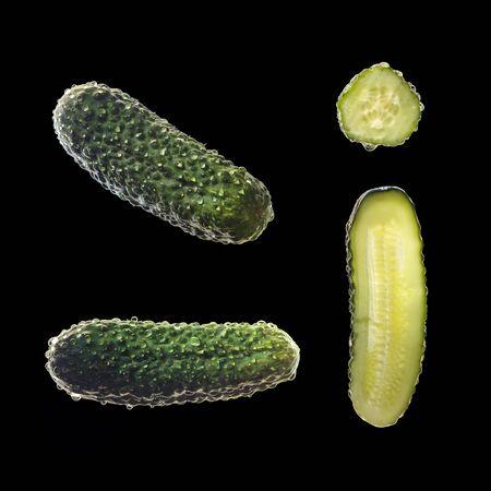 Close up shot of cucumber against black background.