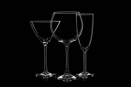 Empty cocktail glassware on a black