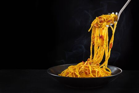 Italian pasta carbonara. On dark background.