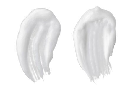 White smear of cosmetic cream or white acrylic paint isolated on white background.