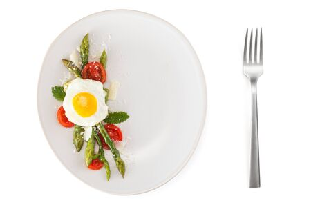Italian food: preserved dish with asparagus and fried eggs.[
