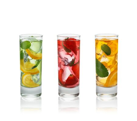 Fresh natural fruit  cocktails with straw on white background.