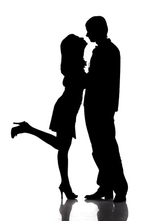 Silhouette of kissing happy couple photo