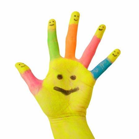 colorful hand with smile painted on palm and happy finger smileys as logo. Symbol of partnership, social network, meeting and hospitality. Isolated on white background Stock Photo - 13400718