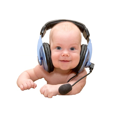 Nice newborn baby boy with blue eyes smiling wearing a headset. Can I help you? Or teaching a foreign language, or listening to a fairy tale photo