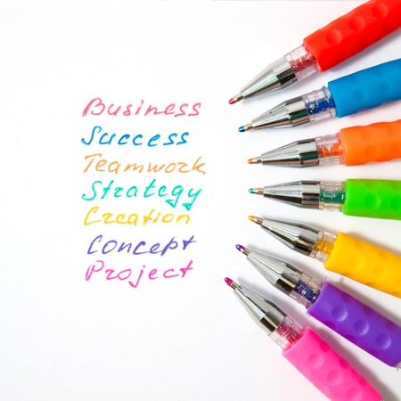 working: Business words are handwritten with colorful pens. Symbol of team work