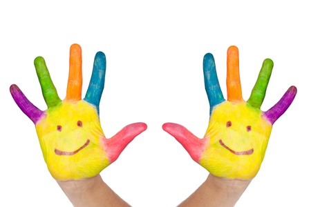 preschool children: The two colorful hands with smile painted with different colors of child as logo Stock Photo