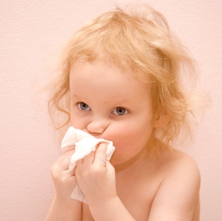 rheum: baby girl with blue eyes is sick  She has a runny nose