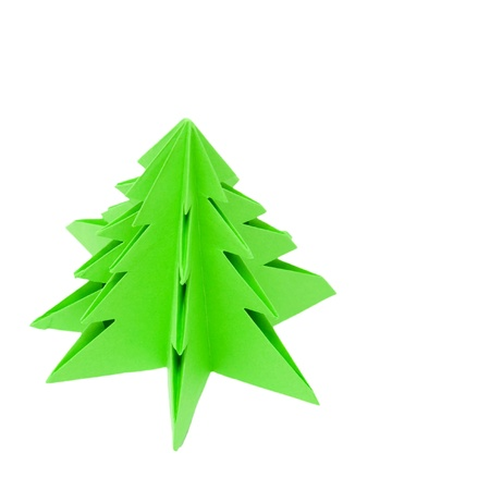Origami Christmas tree, hand made ​​out of green paper in kindergarten photo