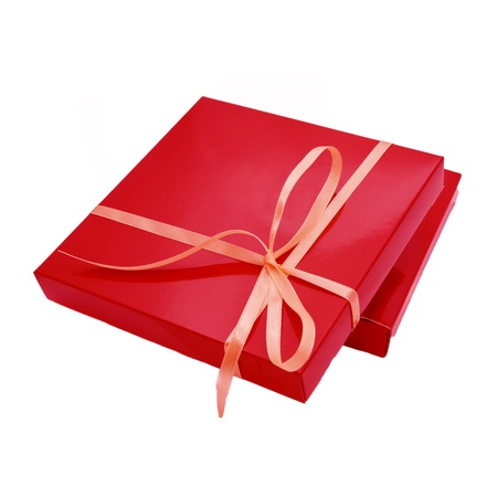 sweet stuff: red color box for chocolate candy, tied beige ribbon. Sweet gift or surprise for your favorite. Ready for your logo, text or symbol. Isolated on white background Stock Photo