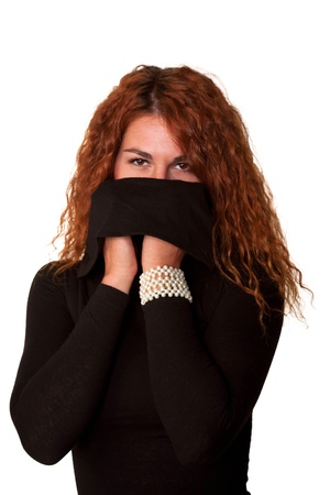 Young curly redhead sexy woman in black sweater hiding face turtleneck photo