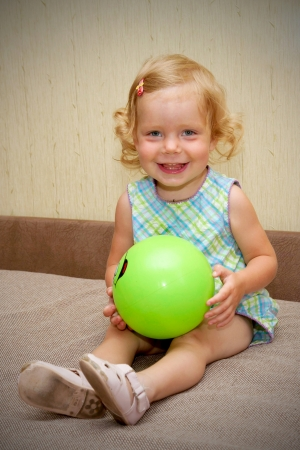 The little blond smiling baby girl with ball Stock Photo - 15687976