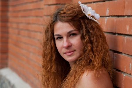 bride against a brick wall photo