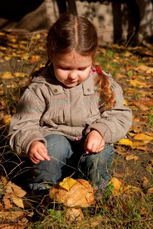 Little girl and big edible mushroom boletus Stock Photo - 15937409