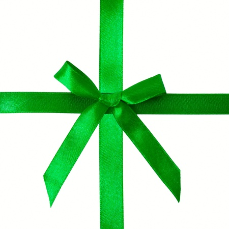 Green satin bow on a satin ribbon. Ready for your text or logo. Festive background or texture. Christmas present Stock Photo - 16410127