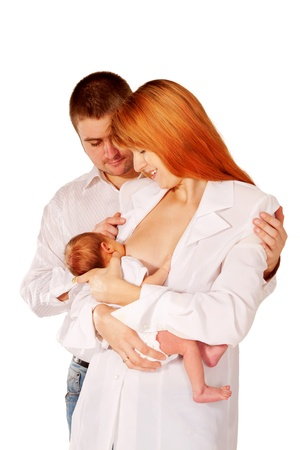Happy family, father mother and baby. Mom breast feeding newborn baby and smiling at him. photo
