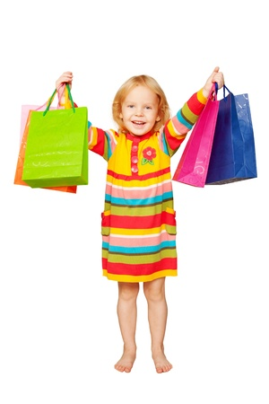 Little beautiful blond girl with shopping bags enjoying purchases  Isolated on white background photo