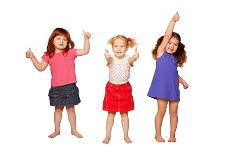 okey: Three lovely smiling little girls, redhead, blonde and brunette, showing thumbs, OK sign or approval  Isolated on white background