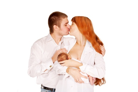 mother milk: Happy family, father, mother and newborn baby. Parents kissing, baby eating Isolated on white background. Family concept.
