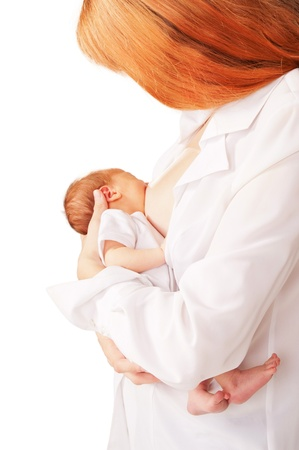 nursing mother: Beautiful red-haired mother breastfeeding  newborn baby