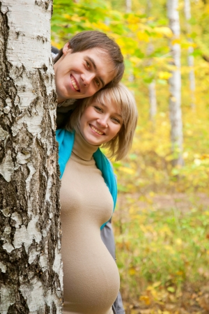childbearing: Happy sunny pregnancy. Beautiful pregnant couple laughing