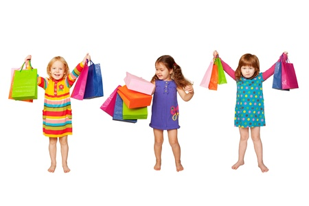 Group of happy little fashion girls with shopping bags  Isolated on white background