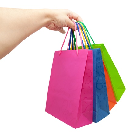 Hand giving colorful paper shopping bags photo