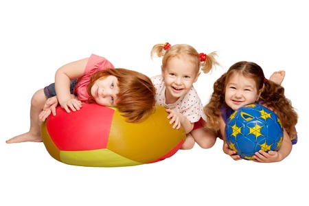 Group of kids lying and playing with balls  Isolated on white background Stock Photo