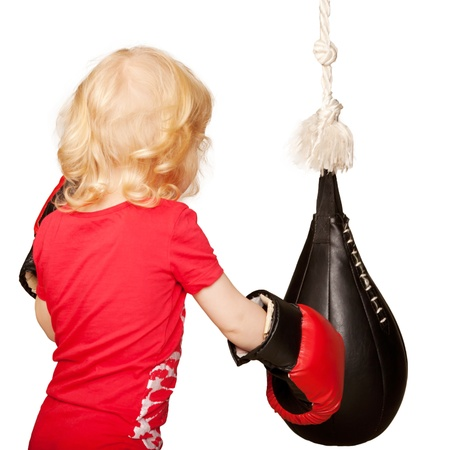 Kid exercising punching bag  Isolated on white background photo