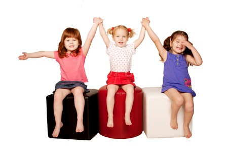Happy smiling children holding hands. Isolated on white background. Stock Photo - 16694596