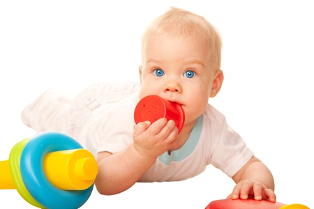 teething: Baby chewing toy  Teething and itching gums  Isolated on white background Stock Photo