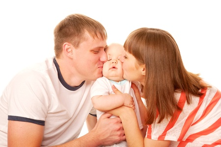 feelings of happiness: Happy family  Parents kissing the kid Stock Photo