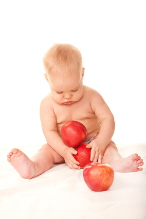 Baby with big red apples on white background. photo