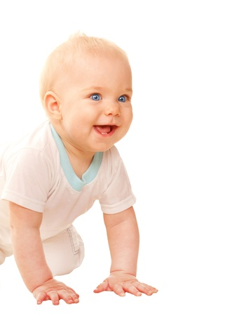 Happy baby crawling, looking out and smiling.  Isolated on white background. Stock Photo