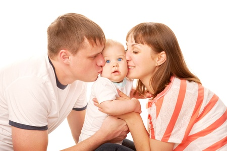 happy family concept: Happy family concept. Parents kissing the kid, the baby smiling. Isolated on white background.