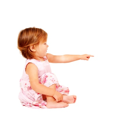 denote: Baby pointing at something or clicking on something. A side view.  Isolated on white background Stock Photo
