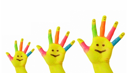 five fingers: Happy family, happy smiles. Father, mother, baby colorful painted hands with smiley face drawn on yellow palms and each finger. Joy and fun. Isolated on white background Stock Photo