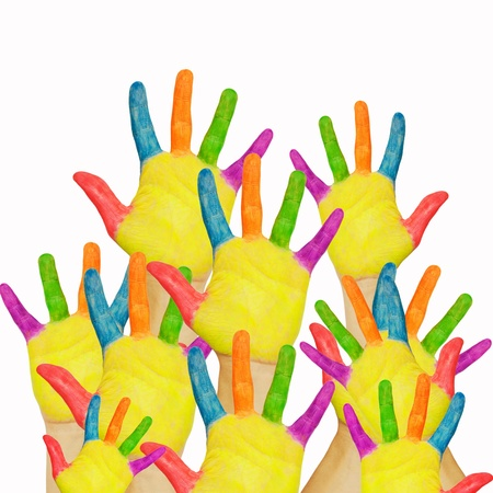 Many painted childrens hands raised up. The concept of classroom, shopping or a friendly group. Isolated on white background. Stock Photo