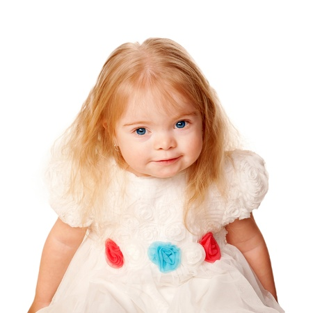down's syndrome: Pretty little girl with blond hair and blue eyes in a beautiful white dress with roses.  Isolated on white background