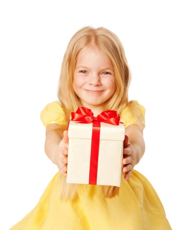 Pretty little girl giving a gift. Festive concept. Selective focus on a box with a gift.  Isolated on white background photo