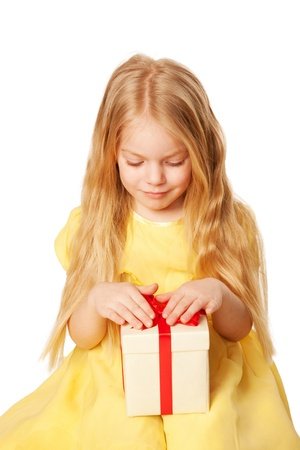 Pretty little girl with gift. Festive concept. Selective focus on a box with a gift.  Isolated on white background photo