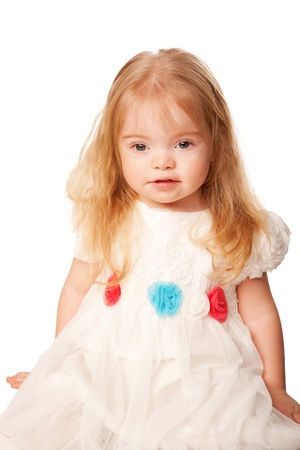 downs syndrome: Pretty little girl with blond hair and blue eyes in a beautiful white dress with roses. Isolated on white background Stock Photo