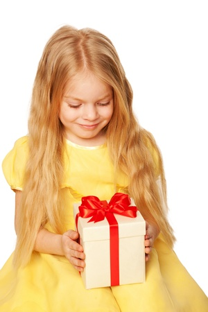 Pretty little girl enjoying gift. Festive concept. Isolated on white background photo