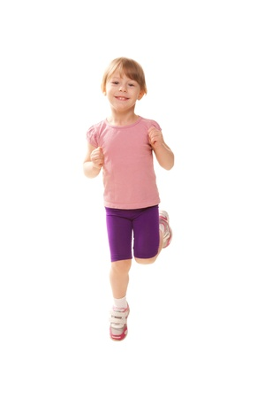 Little girl jogging, playing sports. Stock Photo - 18498655