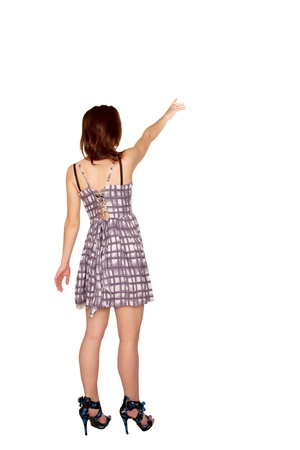back up: Teen girl pointing at something