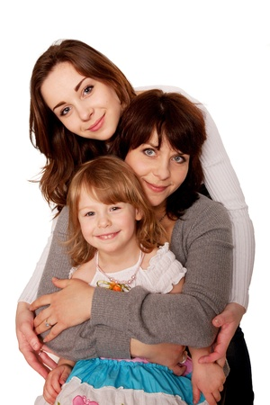 Happy mother and two daughters, a teenager and a toddler. Isolated on white background