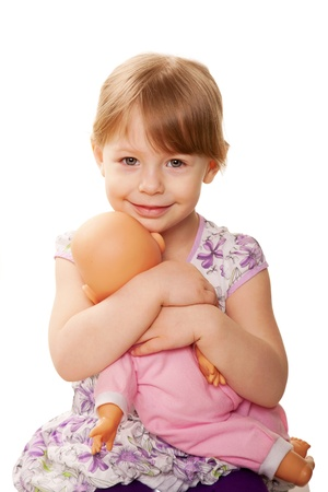 baby doll: Little girl hugging doll. Nursing concept. Isolated on white background