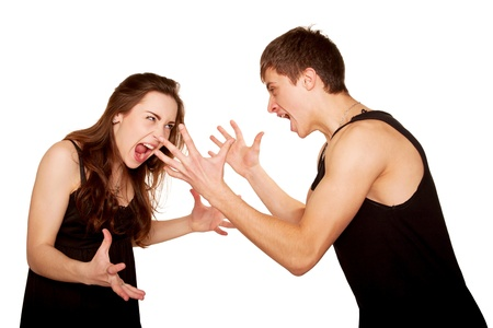 Teenagers boy and girl quarreling, gesticulating and shouting at each other. Isolated on white background Stock Photo - 18661638